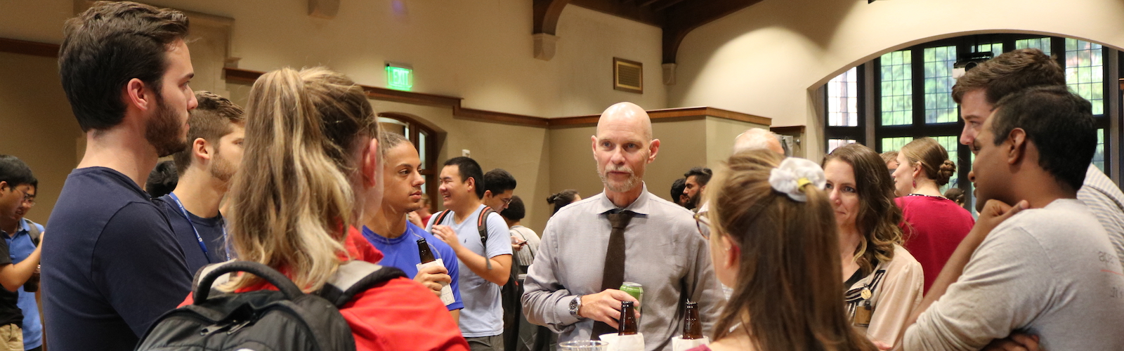 Dean Wallace meets with new Graduate School students at a welcome reception.