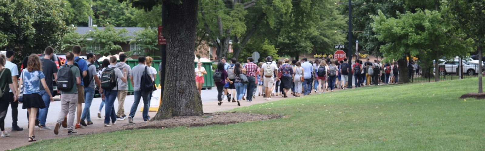 New graduate school students walking from the Student Life Center to Alumni Hall at orientation.